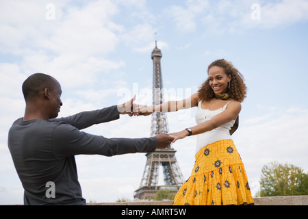 African couple dancing outdoors - Stock Image