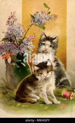 Two Kittens Playing Near Vase of Flowers - Stock Image