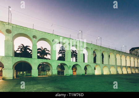 19th-century colonial Lapa Arches, Rio de Janeiro, Brazil at night - Stock Image