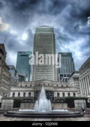 Canary Wharf, Docklands, London. Dramatic sky behind towers. - Stock Image