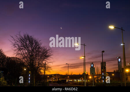 Aberystwyth Wales UK, Wednesday 02 Jan 2019 The clear sky reveals the crescent moon and the bright light of Venus, the morning star, in the dawn light above Aberystwyth, Wales UK Photo Credit: Keith Morris/Alamy Live News - Stock Image