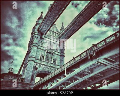 An unusual view of Tower Bridge in London, England. This iconic Victorian structure is a must see for any visitor to London. A view looking up from the River Thames. Photo Credit -© COLIN HOSKINS. - Stock Image