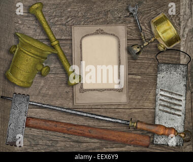 vintage kitchen utensils over wooden board, blank card for your text - Stock Image