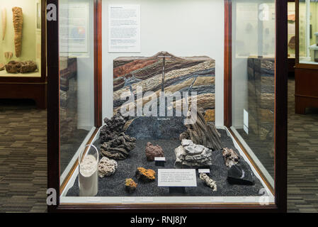 A display model illustrates the formation of volcano and igneous rocks such as granite. The Field Museum, Chicago, Illinois, USA. - Stock Image