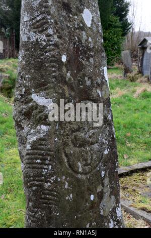 Carving and  Ogham inscription on Bridell Christianised standing stone Nettasagrus Stone  Menhir Ceredigion Wales UK - Stock Image