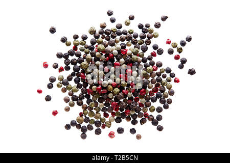 Mixed peppercorns on white background. Different colored peppercorns, close up. - Stock Image