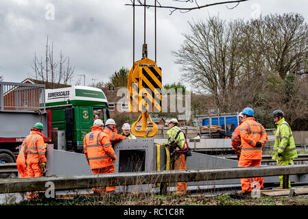 Marlow, United Kingdom. 12 January 2019. The Volvo footbridge which crosses over the A404 near Marlow in Buckinghamshire is being reinstalled after refurbishment works were completed, off site, to the staircases and to the steel elements of the structure. Credit: Peter Manning/Alamy Live News - Stock Image