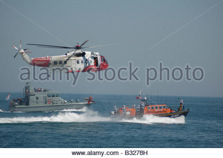 Air sea rescue demonstration helicopter and all weather lifeboat - Stock Image