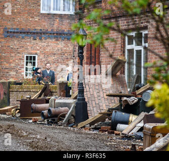 Great Budworth, UK. 11th April, 2018. Actor Rafe Spall with assistants waiting between takes in the new BBC drama 'War Of The Worlds' by HG Wells, film - Stock Image