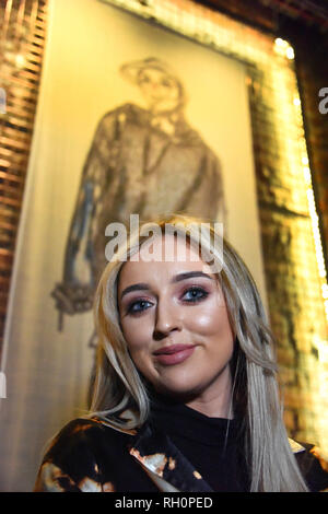 Manchester, UK. 31st January, 2019. MMU student Morgan Allen in front of her Mural hanging in The Yard, Stangeways Credit: Della Batchelor/Alamy Live News - Stock Image