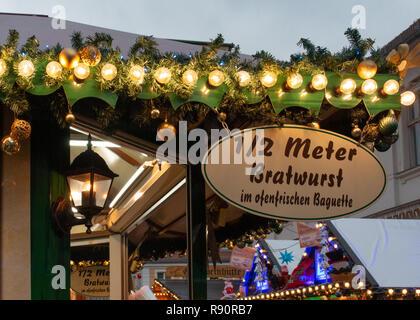 Christmas market stand selling half meter long Bratwursts - Stock Image