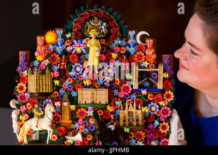 *** EMBARGOED to 00:01 BST, FRIDAY, 21 JULY 2017 *** Pictured: a painted terracotta Tree of Life depicting iconic - Stock Image