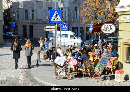 People sitting at a café, street life in Autumn in Vilnius, Lithuania - Stock Image