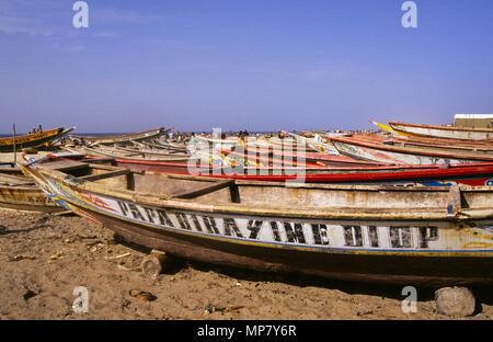 traditional fishing boats on beach, Kayar, Senegal - Stock Image