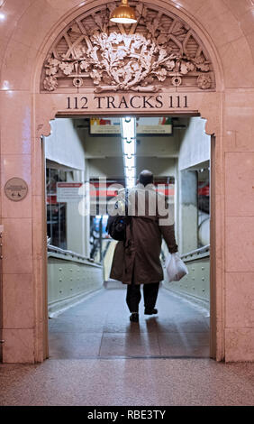 A commuter heads down to the Metro North tracks for the evening commute. At Grand Central Station in Midtown Manhattan, New York City. - Stock Image