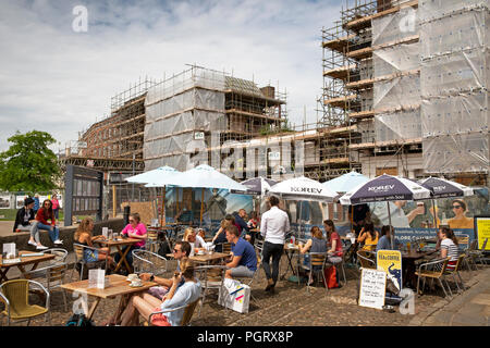 UK, England, Devon, Exeter, Cathedral Yard, pavement cafe tables in front of fire damaged Royal Clarence Hotel - Stock Image