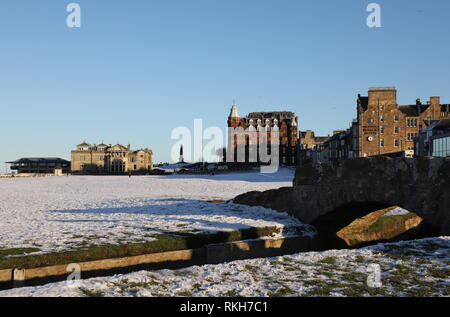 Swilken Bridge and Royal and Ancient Clubhouse with snow St Andrews Fife Scotland   February 2019 - Stock Image