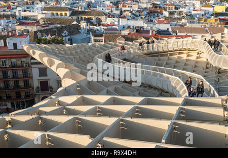 The Metropol Parasol in the old historic quarter of Seville, Spain, is a large wooden mushroom shaped structure popular with tourists to the city. - Stock Image