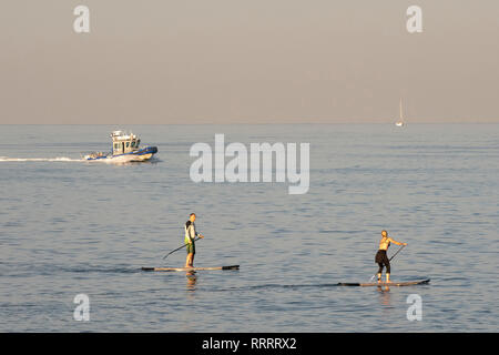 Stand up paddle boarders practicing, Tel Aviv, Israel - Stock Image