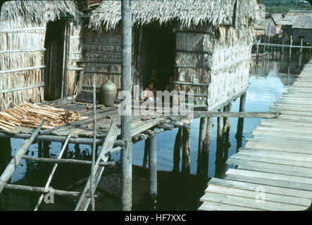 House in a fishing village near Kota Kinabalu; Sabah, North Borneo, Malaysia.  Houses are on stilts with primitive - Stock Image