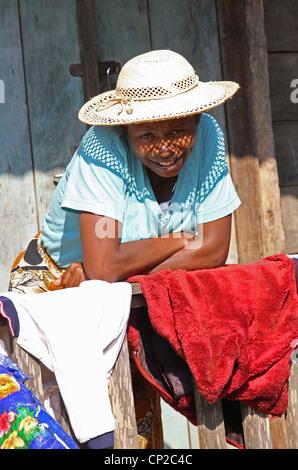 A Malagasy Woman Outside Her House, Andasibe Village, Toamasina Province, Madagascar, Africa. - Stock Image