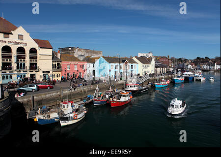 The Rendezvous bar in Weymouth with boats and people outside on a warm summer day - Stock Image