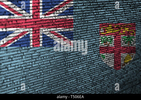 Fiji flag  is depicted on the screen with the program code. The concept of modern technology and site development. - Stock Image