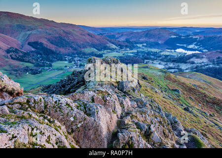Grasmere village and lake, Loughrigg, seen from the summit of Helm Crag, Grasmere, Lake District, Cumbria - Stock Image