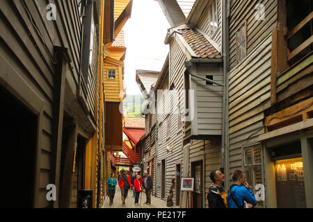 Bergen, Norway - 9 August 2018: A walkway in between the wooden buildng in Bryggen (The Hanseatic Wharf) in the city of Bergen. The UNESCO World heritage site stems its roots from the Viking Age and it today home to many of the citoes restaurants, pubs, craft shops and museums. The city was for many years the centre of trade between Norway and the rest of Europe and is now usually the starting point to  expeditions into the country. Photo: David Mbiyu Credit: david mbiyu/Alamy Live News - Stock Image