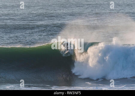 Big wave surfing action at Newquay Cornwall. - Stock Image