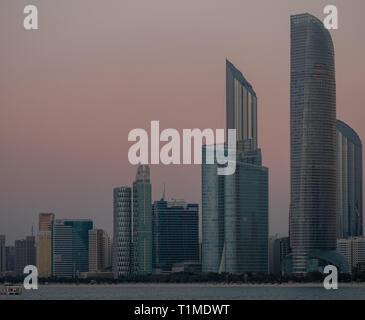 Abu Dhabi Seascape, High rise buildings of Abu Dhabi City at Evening - Stock Image