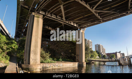 The Iron Cove Bridge that joins the Sydney suburbs of Drummoyne and Rozelle over the upper reaches of Sydney harbour. - Stock Image