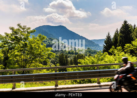 Motorbike on winding road at Pieve Tesino, Trentino, Italy - Stock Image