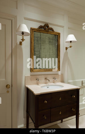 Ornate frame and sink in bathroom - Stock Image