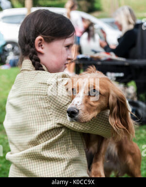 The Barlow Hunt Dog Show - Portrait of a young girl with a Cocker Spaniel dog - Stock Image