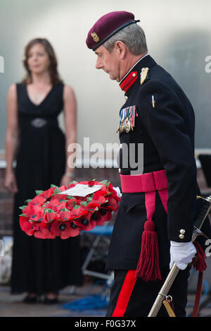 Portsmouth, UK. 15th Aug, 2015. A wreath is brought to be laid at the Portsmouth Cenotaph during the VJ Day 70 memorial. - Stock Image