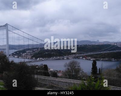 Bridge Over River With City In Background - Stock Image
