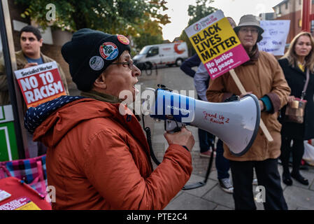 London, UK. October 9th 2018. A woman from the RMT speaks at the rally outside the New Atlas Cafe Restaurant where a young black man was attacked by police who used obviously unnecessary force when arresting him on suspicion of having been involved in a knife attack. He was assaulted by six officers, and was viciously kicked while officers struggled to handcuff him, andwhen he was well under control and held on the ground he was sprayed in the face with CS gas. Credit: Peter Marshall/Alamy Live News - Stock Image