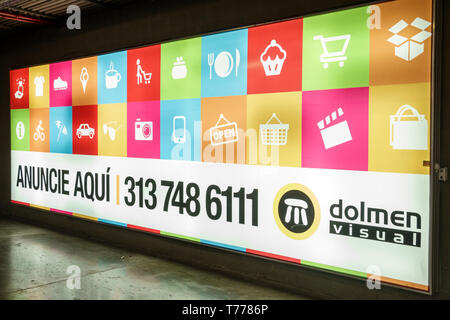 Cartagena Colombia Bocagrande Square Mall Plaza exterior sign vertical shopping center centre shopping inside backlit billboard advertise here Spanish - Stock Image