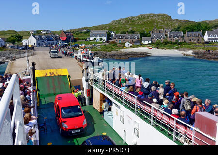 CalMac ferry arriving at Iona from Fionnphort on the Isle of Mull - Stock Image