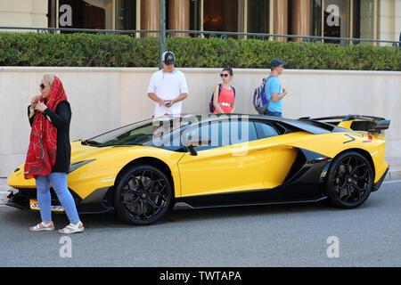 Monte-Carlo, Monaco - June 21, 2019: Black And Yellow Lamborghini Aventador SVJ Roadster (Side View) Parked In Front Of The Hotel De Paris Monte-Carlo - Stock Image