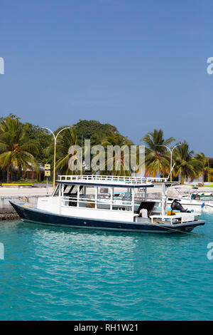 Maldives boat - a boat in the harbour, Ukulhas Island, Alif Alif atoll, the Maldives, Asia - Stock Image