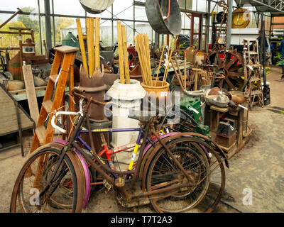 Collection of antique and vintage country or farm artifacts for sale in a North Yorkshire Garden Centre - Stock Image