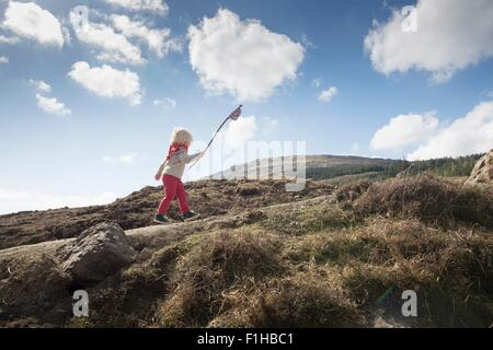 Boy carrying flag, Fairy Pools, Isle of Skye, Hebrides, Scotland - Stock Image