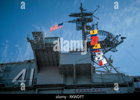 Flags on the USS Midway Museum. - Stock Image