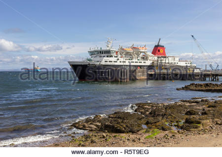 Ferry moored at the pier in the town of Brodick on the Isle of Arran in Scotland, UK. - Stock Image