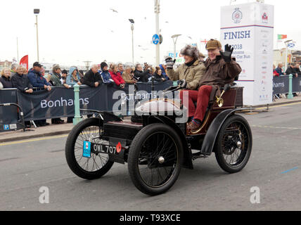 A 1899 Wolseley, entered by the British Motor Museum, crosses the finishing line, during the 2018 London to Brighton Veteran Car Run - Stock Image
