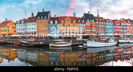 Nyhavn at sunrise in Copenhagen, Denmark. - Stock Image