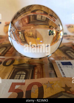 Concept : Business and Finance. Crystal ball and euros - Stock Image