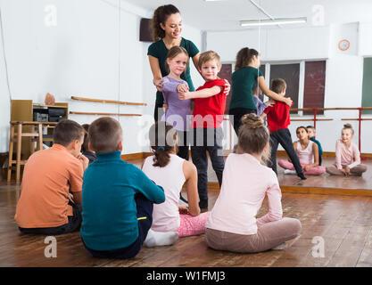 little kids dancing pair dance in the ballet studio - Stock Image